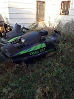 Old snowmobiles, lots of parts