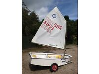 Optimist sailing dinghy with two sails and trolley. Good condition