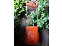 Flymo electric garden rake with collection box