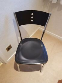 Four Barker and Stonehouse Chrome and Black metal dining chairs with plastic seats. Good Condition.
