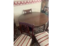 Round extending dining table and 4 chairs