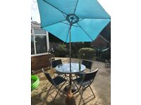 4 seater glass table and chairs
