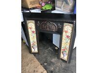 Cast iron fire surround with tiles excellent condition
