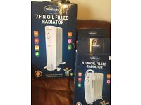 Silent night Portable radiators - oil filled . Nearly new .Bargain at £20 for all !