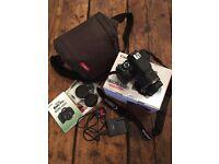 Canon EOS 650D / Rebel T4i Digital SLR Camera + 18-55mm Zoom Lens Bundle