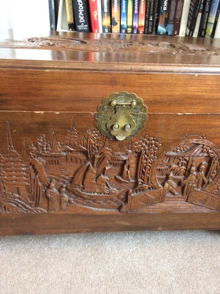 Vintage wooden chest. Beautiful carved detail on top and side. Cedar wood lined.