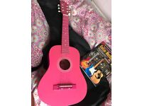 Pink girls guitar! Including bag, music stand & 2 music books.