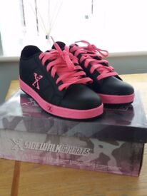 Pink and Black Heeleys Size 4