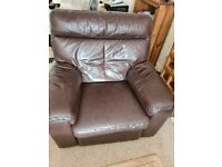 LEATHER RECLINER ELECTRIC ARMCHAIR WITH MATCHING POUFFEE.