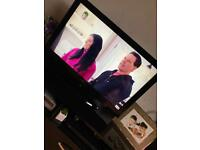 """32"""" black tv with stand"""