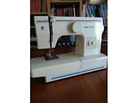Sewing machine, Riccar 2400, excellent condition, c/w manual and various attachments.