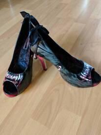 Ladies size 6 Iron Fist heels