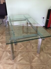 Extending glass and chrome dining table by Harveys.
