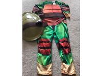 Teenage mutant ninja Turtle dressing up and shell
