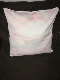 Pink and white marble effect cushion
