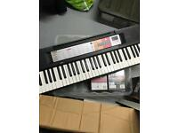 Yamaha PSR F50 Electric Keyboard + Stagg Keyboard stand. NEW!