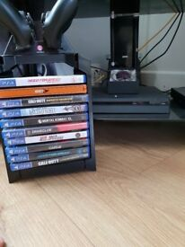 Ps4 perfect condition a bunch of games 2 controllers and charger docking station