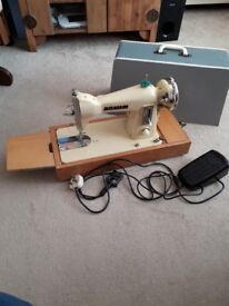 Novum sewing machine with cover