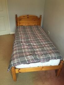 Single Sized Wooden Bed with Headboard