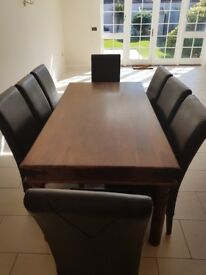 Solid Table with 8 Leather chairs