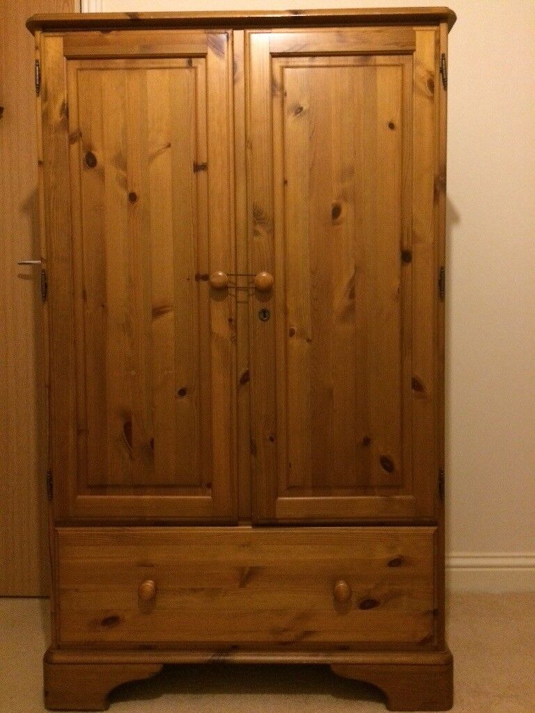 3/4 Solid wood wardrobe. Good condition. Without key so I use a hair band to keep doors closed.