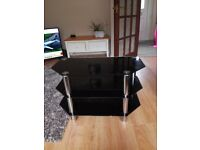 Black glass tv stand, holds up to 40 inch tv