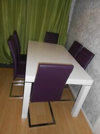 Harvey's morano high gloss white table and six Alcora chairs in purple.
