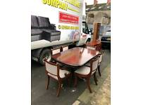 Very old table and 6 chairs with 2 carvers (in as new condition)