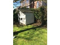 Free on collection - wooden two storey playhouse. It's on my patio space and needs to go