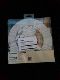 Brand new Wilko coiled curtain track