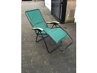 Green reclining garden chairs and loungers
