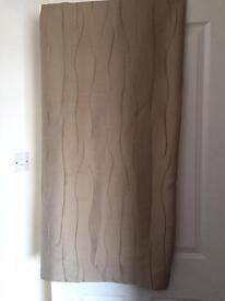 Cream eyelet pair curtains