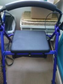 4 wheeled walker. With padded seat with back rest