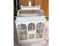 Gorgeous wooden bird cage great for wedding