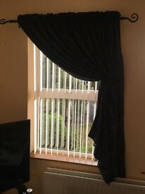Dark blue curtains with poles and wall hooks