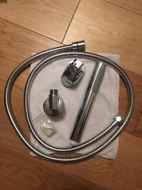 Brand new modern shower head and optional wall fixing kit