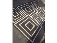 Large black and cream patterned rug