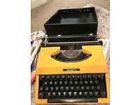 Silverette yellow vintage type writer
