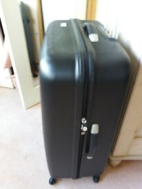 Large black hard suitcase