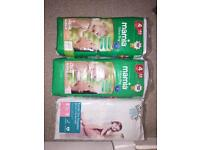3x unopened packs of nappies size 4