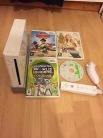 Nintendo Wii console complete with 4 games. Tested