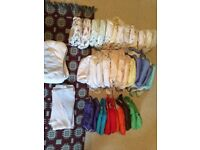 Huge bundle of reusable/real/washable nappies birth to potty
