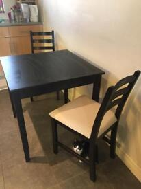 Black Dining table with two chairs