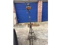 Victorian oil lamp with wrought iron stand, delivery available