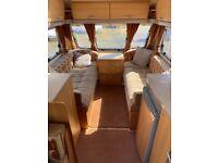Swift Oransay (2006) 6 berth fixed bunk caravan with motor mover
