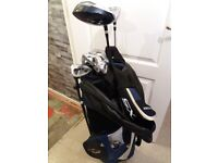 Golf bag with own stand and some clubs
