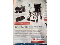 Travel wheelchair - Never used. Mint condition. Easy foldable and comes with travel bag. £50.