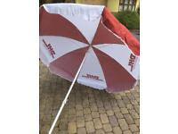 4 New & Unused Garden umbrellas