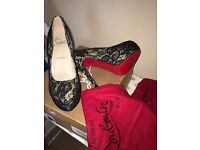 Authentic Christian LOUBOUTIN ( new in box )