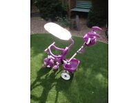 Childs stroller / 1st ride on tricycle with loads of add on accessories £10